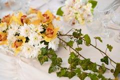 Floral arrangement. On wedding day meals Stock Photos