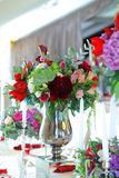 Floral arrangement wedding tent White canopy. Serving on the table restaurant catering elegant floral arrangement wedding tent White canopy Stock Images