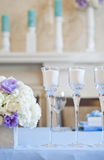 Floral arrangement with white and blue flowers and candles on candle holders. Wedding decor Stock Photography