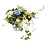 Floral arrangement of white roses, ivy and orchids. Flower composition of white roses, ivy and orchids, isolated image on a white background. Bouquet of Royalty Free Stock Image