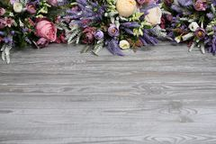 Floral arrangement on wooden texture background. Backdrop with copy space .Horizontally arranged Royalty Free Stock Photos