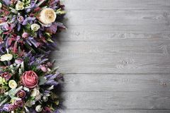 Floral arrangement on wooden texture background. Backdrop with copy space .Horizontally arranged Stock Photo