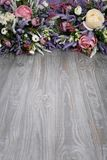 Floral arrangement on wooden texture background. Backdrop with copy space .vertically located Stock Images