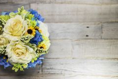 Floral Arrangment on Distressed Wood Surface Left Side royalty free stock image