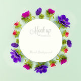 Floral background. Anemone flowers and round paper with copy space. Stock Photo