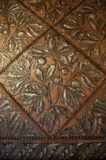 Floral background. Close-up of an old leather wallpaper embossed with floral motifs Royalty Free Stock Image
