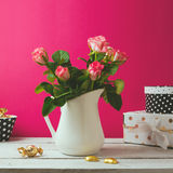 Floral background with rose flower bouquet with chocolate Royalty Free Stock Photo