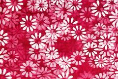 Floral background of white flowers printed on a red net material stock illustration