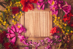Floral background with wooden board. Stock Image