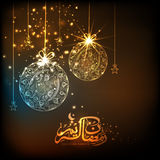 Floral balls and Arabic text for Ramadan Kareem celebration. Stock Photos