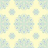 Floral beige seamless pattern. Beige background with light blue and green flower designs. For wallpapers, textile and fabrics Royalty Free Stock Photos