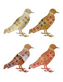Floral Birds. A set of bird silhouettes with a texture and hand drawn flowers and tribal designs Stock Image