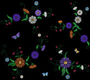 Floral blue violet daisy embroidery seamless pattern. Vintage Victorian flower ornament fashion textile decoration Royalty Free Stock Images