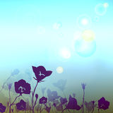 Floral blurry background with sunlight flare. Design flowers with a place for your message. Texture of a blurry abstract stylish background. Solar glare Stock Photo