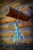 Floral Boquet of flowers drying on beam of log cabin Royalty Free Stock Photo