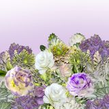 Bouquet of Eustoma Lisianthus flowers and ornamental cabbage -. Floral border with bouquet of purple with white Eustoma Lisianthus flowers and ornamental cabbage Royalty Free Stock Photo