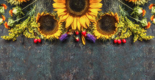 Floral border with sunflowers on dark vintage background, top view, place for text Stock Images