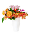 Floral bouquet arrangement centerpiece in white vase isolated. Stock Photos