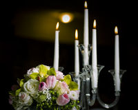 Floral bouquet and candles Royalty Free Stock Photo