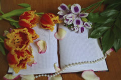 Floral bouquet and notebook royalty free stock photo