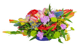 Floral bouquet of orchids, gladioluses and carnations. Arrangement centerpiece in blue glass vase isolated on white background Stock Images