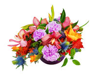 Floral bouquet of orchids, gladioluses and carnations arrangement. Centerpiece in blue glass vase isolated on white background Royalty Free Stock Photo