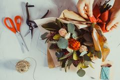 Floral bouquet preparation. Close up bouquet preparation. Small business concept Royalty Free Stock Photo