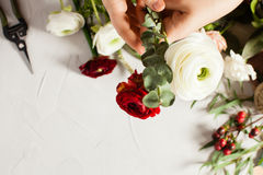 Floral bouquet preparation. Top view bouquet preparation with copy space. Small business concept Royalty Free Stock Photos