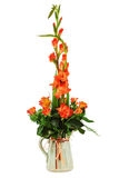 Floral bouquet of roses and gladioluses arrangement centerpiece. In vase isolated on white background. Closeup Royalty Free Stock Photo