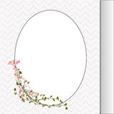 Floral twig on oval frame Royalty Free Stock Photo