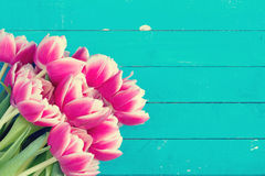 Floral card: pink peony tulips on vintage wooden background Stock Photos