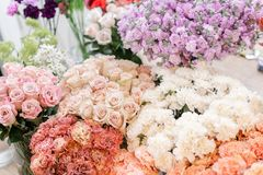 Floral carpet, flower texture, shop concept. Beautiful fresh blossoming flowers roses, spray roses, lilac gillyflower stock images