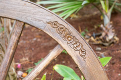Floral carving on a wooden wheel in a park Stock Photo
