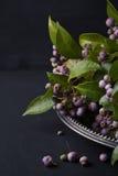 Floral centerpiece arrangement on a silver platter Stock Photos