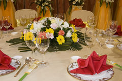 Floral Centerpiece at Banquet. Table setting for an oriental banquet with a centerpiece of gerbera daisies and other flowers Stock Images
