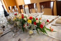 A floral centerpieces and tea cerimony Royalty Free Stock Photos