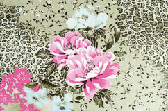 Floral and cheetah pattern on fabric. Stock Photography