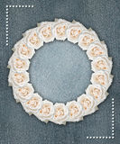 Floral circular frame with denim background Royalty Free Stock Photo