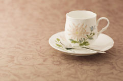 Floral coffee cup. Royalty Free Stock Photos