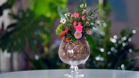Floral composition against the backdrop of greenery stock video footage