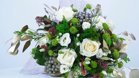 The floral composition consists of eucalyptus, solidago, Rose of avalanche, Santini , Eustoma, Brunia green, Barbatus. Flowers, bouquet, rotation on white stock video footage
