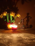 Floral Composition. Flowers in a vase illuminated by the light of a candle Royalty Free Stock Images