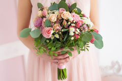 Floral composition in hands of young girl Stock Image