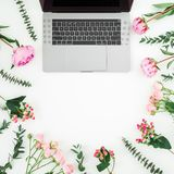 Floral composition with laptop and pink flowers on white background. Top view. Flat lay. Floral composition with laptop and pink flowers on white background. Top royalty free stock photography