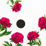 Floral composition with peony flowers and coffee mug on white background. Flat lay, top view. Floral composition with peony flowers and coffee mug on white Stock Photos