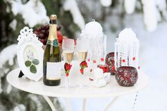 Floral composition of roses, on snow table in winter forest. Winter wedding decor concept. Floral composition of red roses, on snow table in winter forest Royalty Free Stock Image
