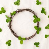 Floral composition. Wreath made of roools, leaves, and flowers on tissue white background. Rustic style of home decor, flat lay, t. Op view. St.Patrick`s Day royalty free stock photography