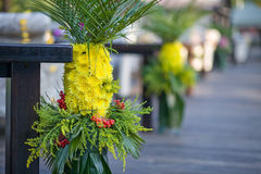 Floral composition of yellow daisies and palm leav Stock Image