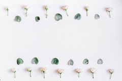 Floral concept with pastel flowers on white background top view mock-up Royalty Free Stock Photo