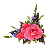 Floral corner arrangement with begonia and small blue flowers. Isolated on white background. Flat lay. Top view Royalty Free Stock Photos